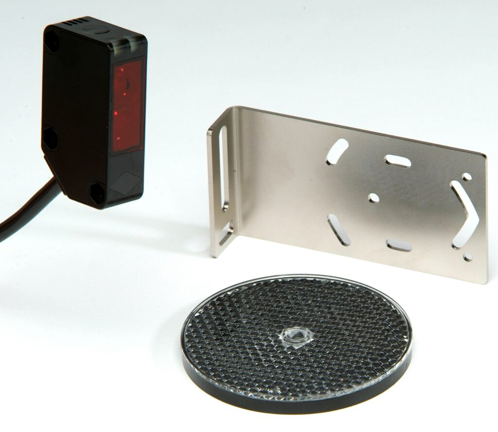 Hotron RLK31 Industrial Automatic Door Reflective Light Barrier with bracket and reflector.