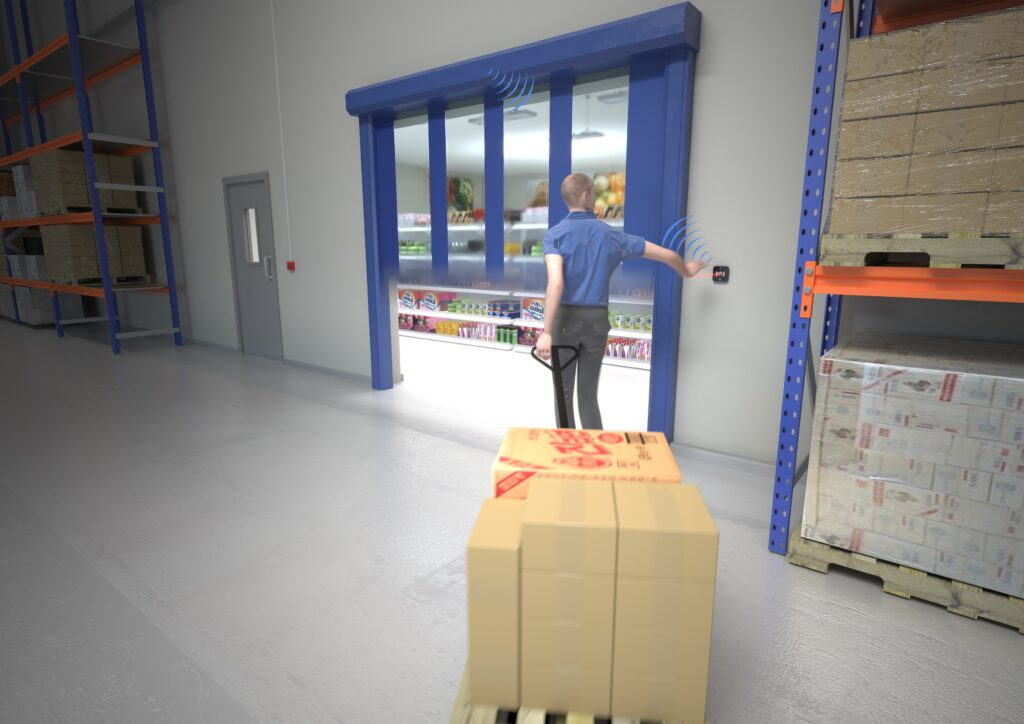 Worker in industrial factory using Hotron AerWave hygienic, touchless and wireless automatic door activation switch.